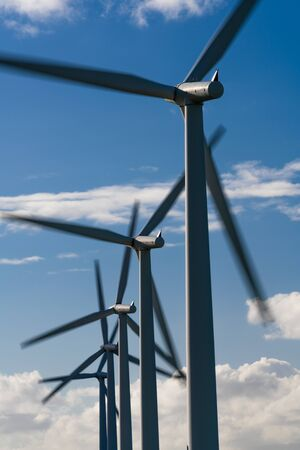 Wind turbine energy generaters on wind farm Stok Fotoğraf - 129388631