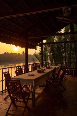 Sunset at a restaurant by the Megong Delta, Vietnam Stok Fotoğraf - 129388708