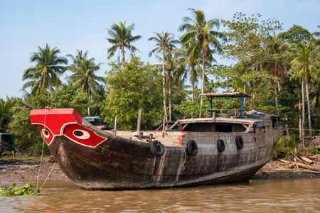 Wooden boats with painted eyes on Megong Delta, Vietnam