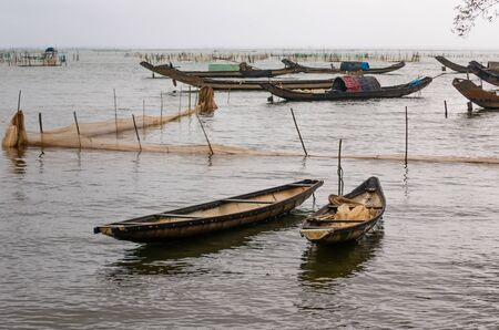 Fishing nets and boats near Da Nang, Vietnam Stock Photo