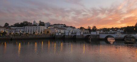 Sunset over the Roman Bridge across the River Gilao in Tavira, Eastern Algarve, Portugal