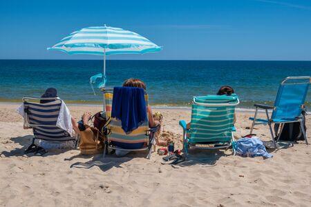 Relaxing on the beach at Tavira Island or Ilha de Tavira, Eastern Algave, Portugal 版權商用圖片
