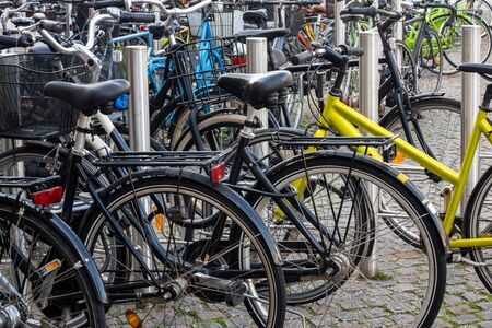 Numerous bicycles parked in the street, Copenhagen, Denmark Stok Fotoğraf