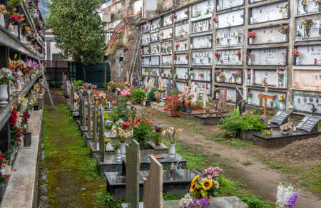 View of the famous hillside cemetery with graves and crypts, decorated with bouquets of flowers, on the Amalfi coast,Campania, Italy Editöryel