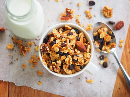 Homemade baked granola with almond,walnuts,raisin and seed for breakfast Stock Photo