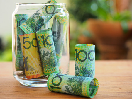 Dollar australia bank note saving in glass