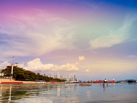 Beautiful sky and cloud reflect on wet sand beach in summer season for background with copy space.