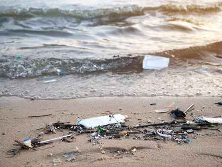Dirty beach with plastic and foam garbage,sea pollution.