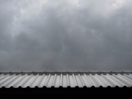 flit: Dark storm cloud over the roof in rainy season. Stock Photo