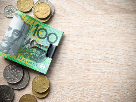 Dollar australia banknotes and coins on wooden table with copy space for money concept. 版權商用圖片