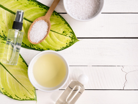 Natural skincare products,aromatherapy oil and salt on white wooden table with copy space. Stock Photo