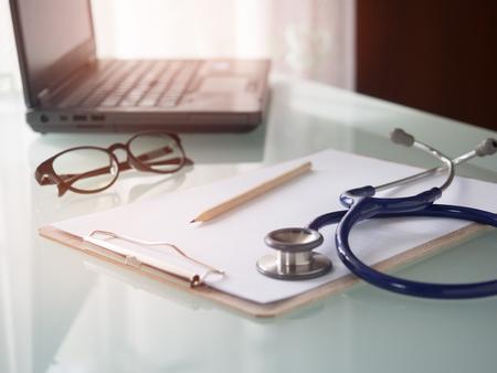 laptop on doctors working desk in hospital.