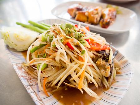 Spicy papaya salad with salted crab or somtum famous  traditional Thai food.