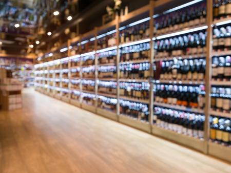 Blurred winery store department in supermarket for background. Reklamní fotografie