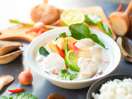 Thai galangal chicken soup in creamy  coconut milk or Tom Kha Gai,famous traditional Thai food in white bowl.