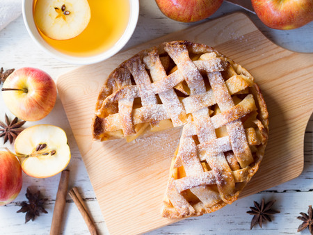 Homemade apple pie for afternoon tea meal in autumn season in top view. Stock Photo