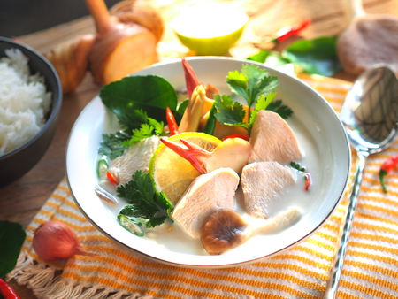 Thai galangal chicken soup in creamy  coconut milk or Tom Kha Gai,famous traditional Thai food in morning sunlight.