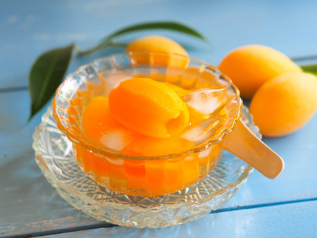 Marian plum or plango fruit in syrup serve with ice, Thai dessert in summer season.