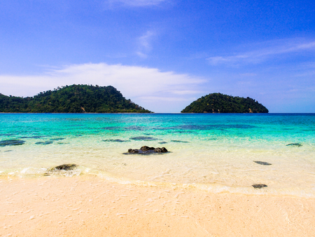 White sand beach and blue sea with clear sky in sunny summer day for holiday or vacation concept,Thailand. Stock Photo