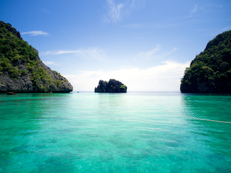 Beautiful turquoise sea water with mountains background at Horse shoe Island in Myanmar.