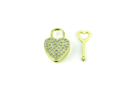Heart golden key souvenir on white background photo
