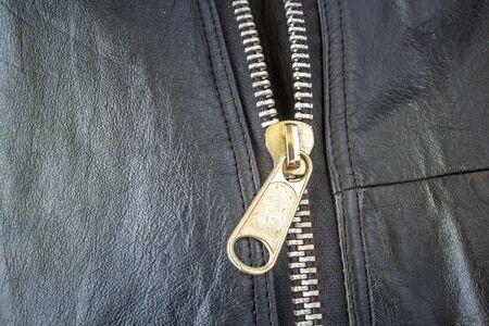 black leather texture: Black leather texture background with zipper Stock Photo