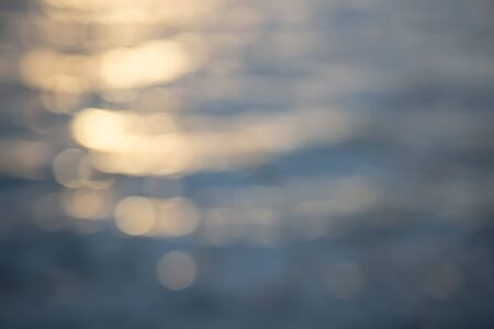 Water reflection blur golden bokeh background Stok Fotoğraf