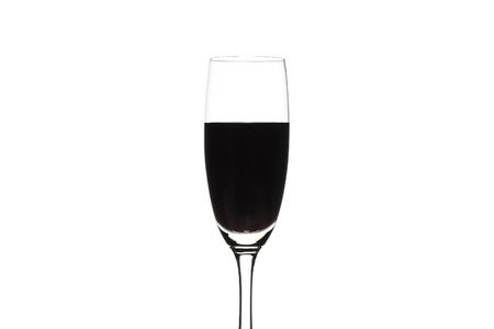 dark purple: Dark purple water in glass on white background