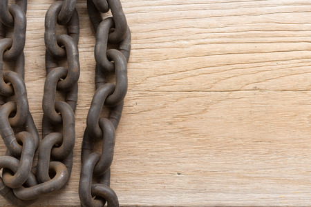 Rusting chain on wood board