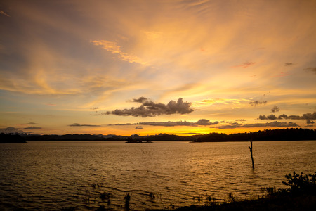 Sunset over lake colorful twilight
