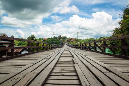 Long wood bridge with cloud blue sky