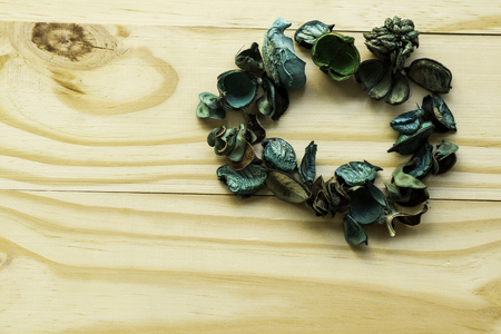 Dry flower on wood background
