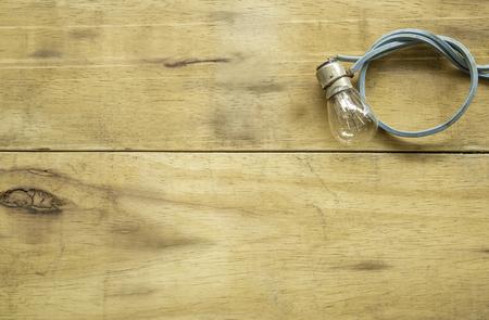 D.I.Y light bulb on wood background