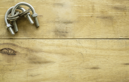 clamp bolts and nuts on wood background Stok Fotoğraf - 101856698