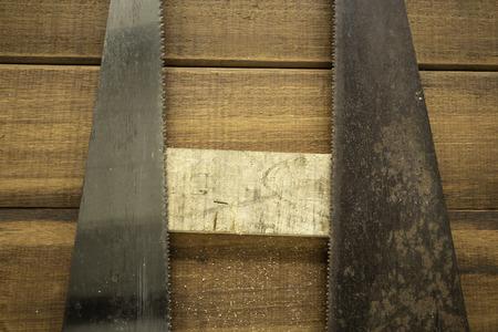 Hand wood saw on wood background