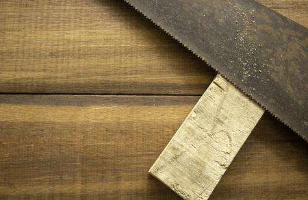 Hand wood saw on wood background Stok Fotoğraf - 101856443