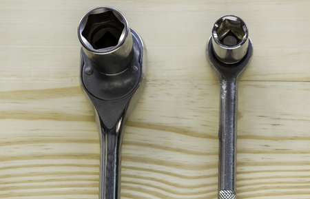 Block wrenches on wood background Stok Fotoğraf - 101856445