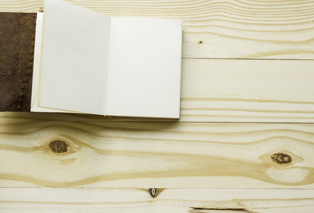 Open leather book on wood background Stok Fotoğraf