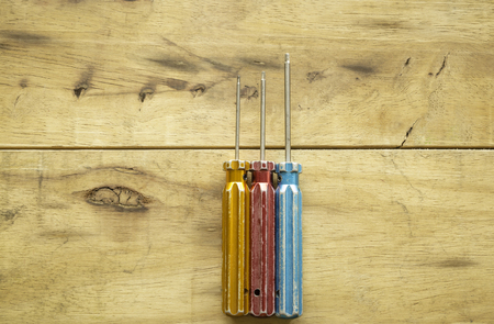 Set of screwdriver on wood background