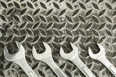 Wrench on Dirty metal plate background texture Stok Fotoğraf - 101857795