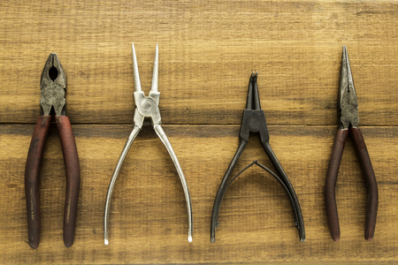 Pliers on wood background