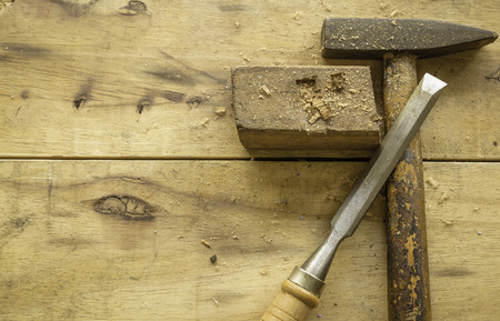 Hammer and Chisel on wood background Stok Fotoğraf