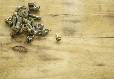 Bolts and nuts on wood background