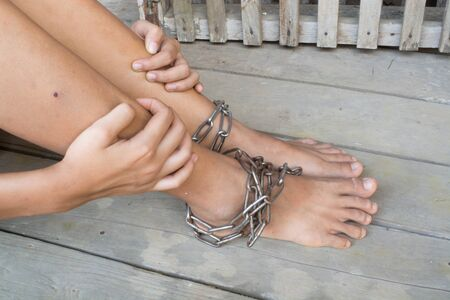 incarceration: Child was gets foot interpreter by the chains