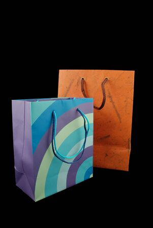 two colored paper gift bags