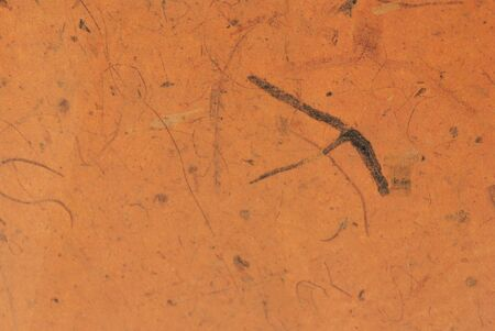 terracotta achtergrond met subtiele patroon