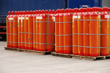 liquefied: pallets of red gas cylinders Stock Photo