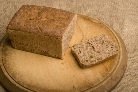 loaf of rye bread with one slice removed