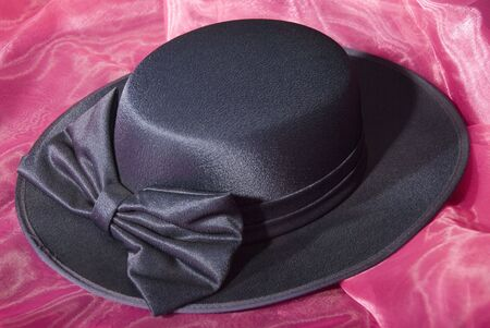 dark blue ladies dress hat with ribbon Stock Photo