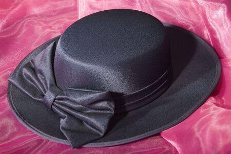 dark blue ladies dress hat with ribbon Banco de Imagens